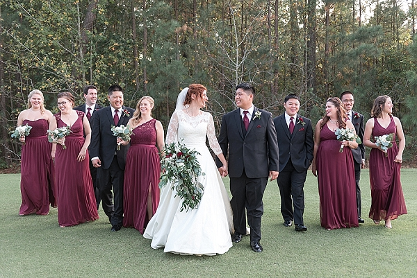 Classic wedding party with red bridesmaid dresses and red groomsmen neckties
