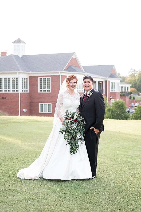 Redhead bride with cascade bouquet