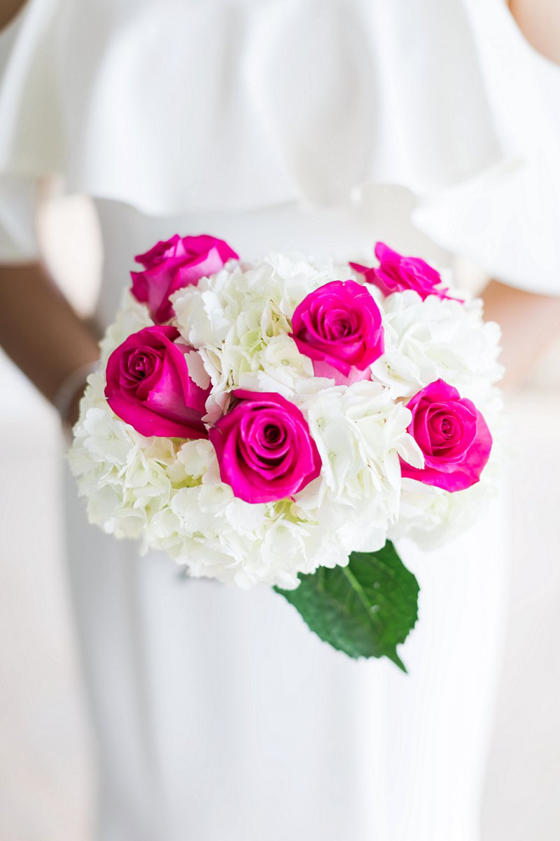Simple wedding bouquet with white hydrandeas and bright pink roses
