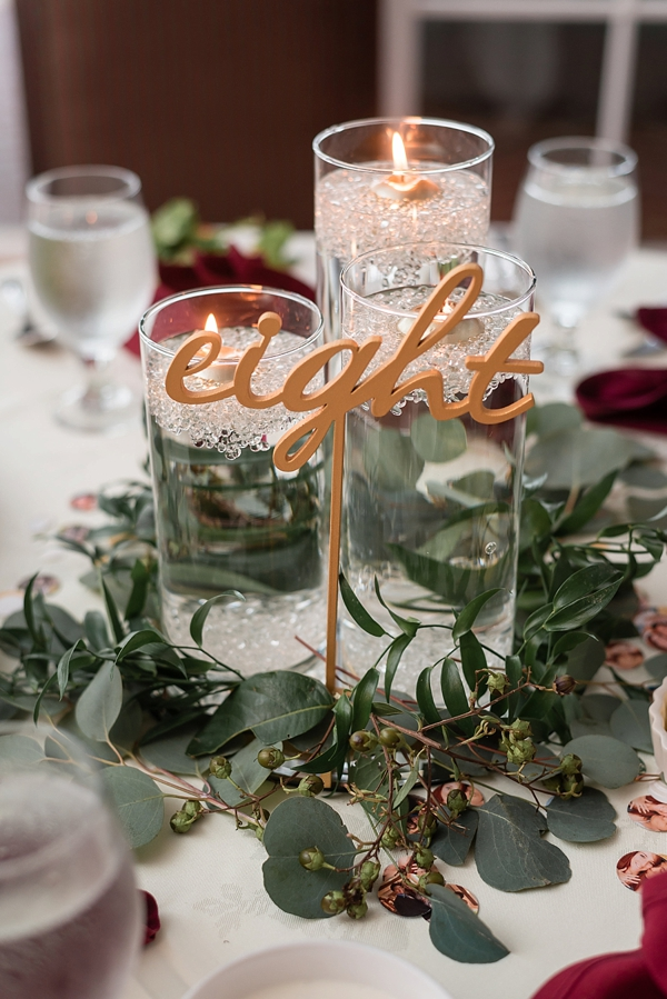 Gold cursive wedding table numbers