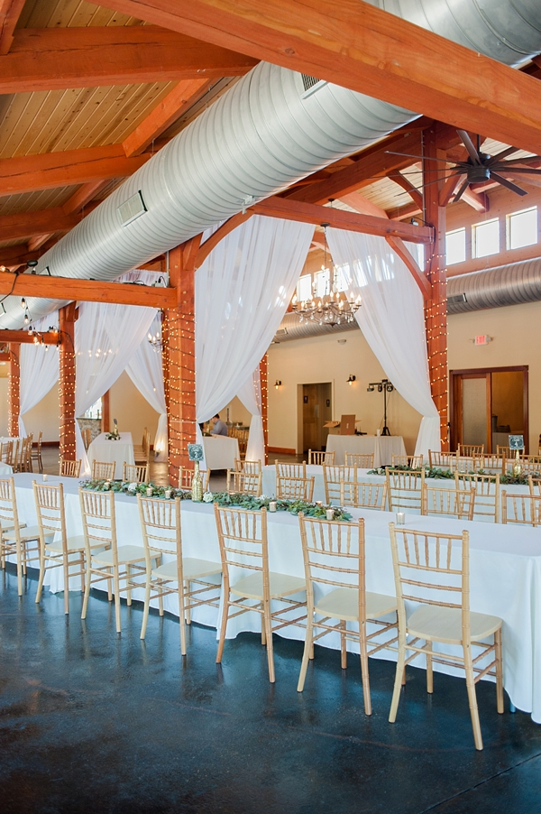 Gold chiavari chairs and long banquet tables for rustic elegant vineyard wedding