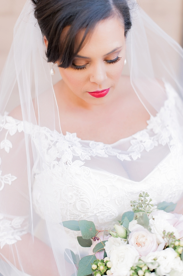 Elegant bride with bold red lip