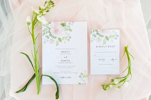 Pretty watercolor invitations with eucalyptus and roses