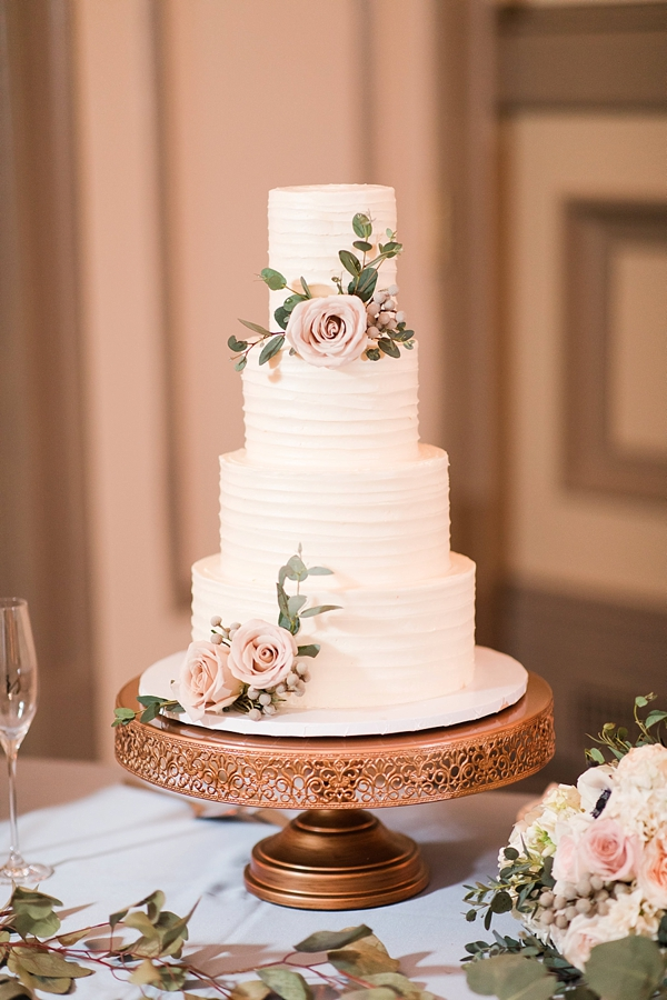 Simply textured 4 tier wedding cake with floral details