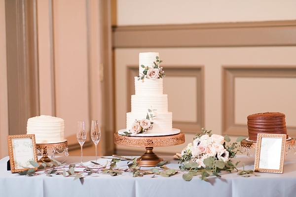 Classic dessert table with wedding cake and two personal cutting cakes