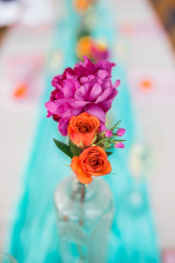 Bright and vibrant flowers in bud vases for simple wedding centerpiece idea