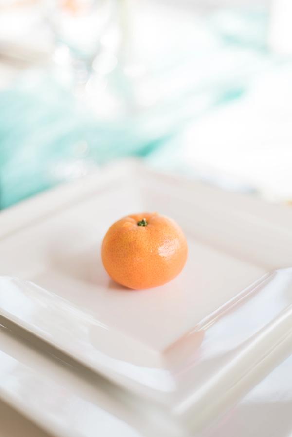 Simple mandarin orange fruit detail for summer wedding place setting