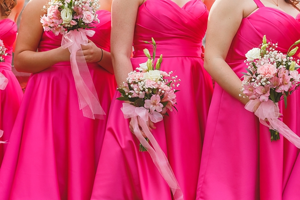 Bright pink bridesmaid dresses and pink bouquets