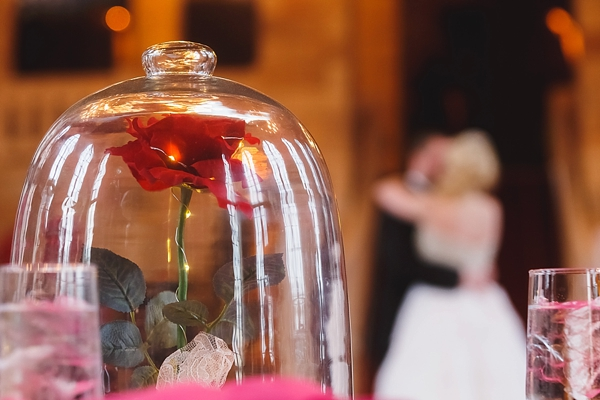 Beauty and the Beast rose in a bell jar wedding centerpiece