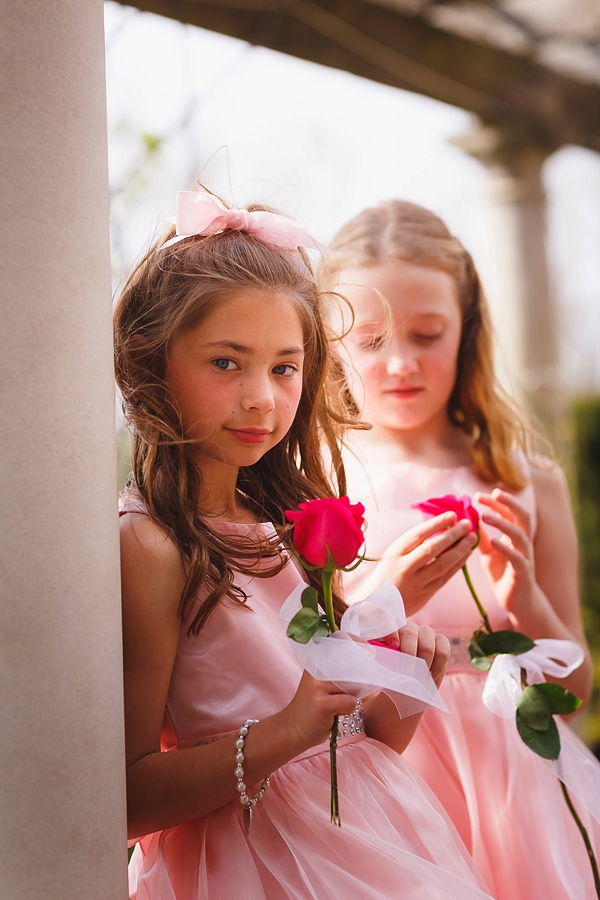 Flower girls with single pink rose