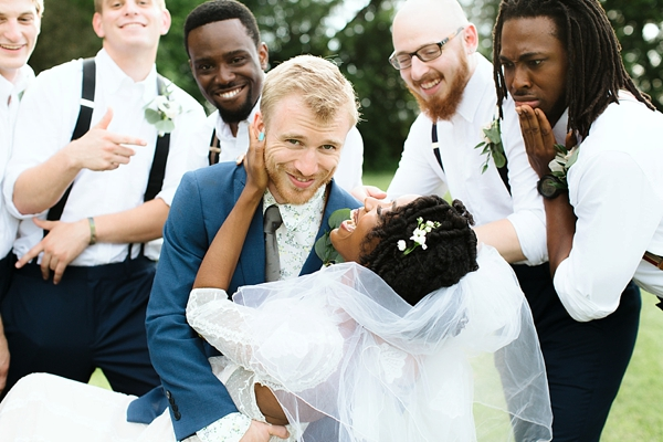 Adorable bride and groom moment with their wedding party