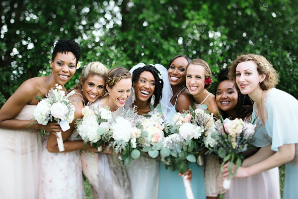 Bridesmaids in mismatched dresses of pink and aqua for outdoor barn wedding in Virginia