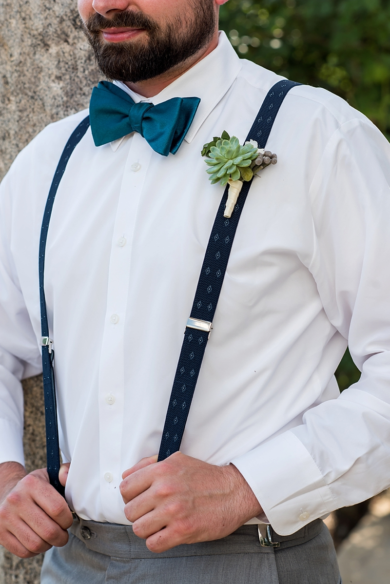 Blue suspenders and succulent boutonniere for garden wedding groom
