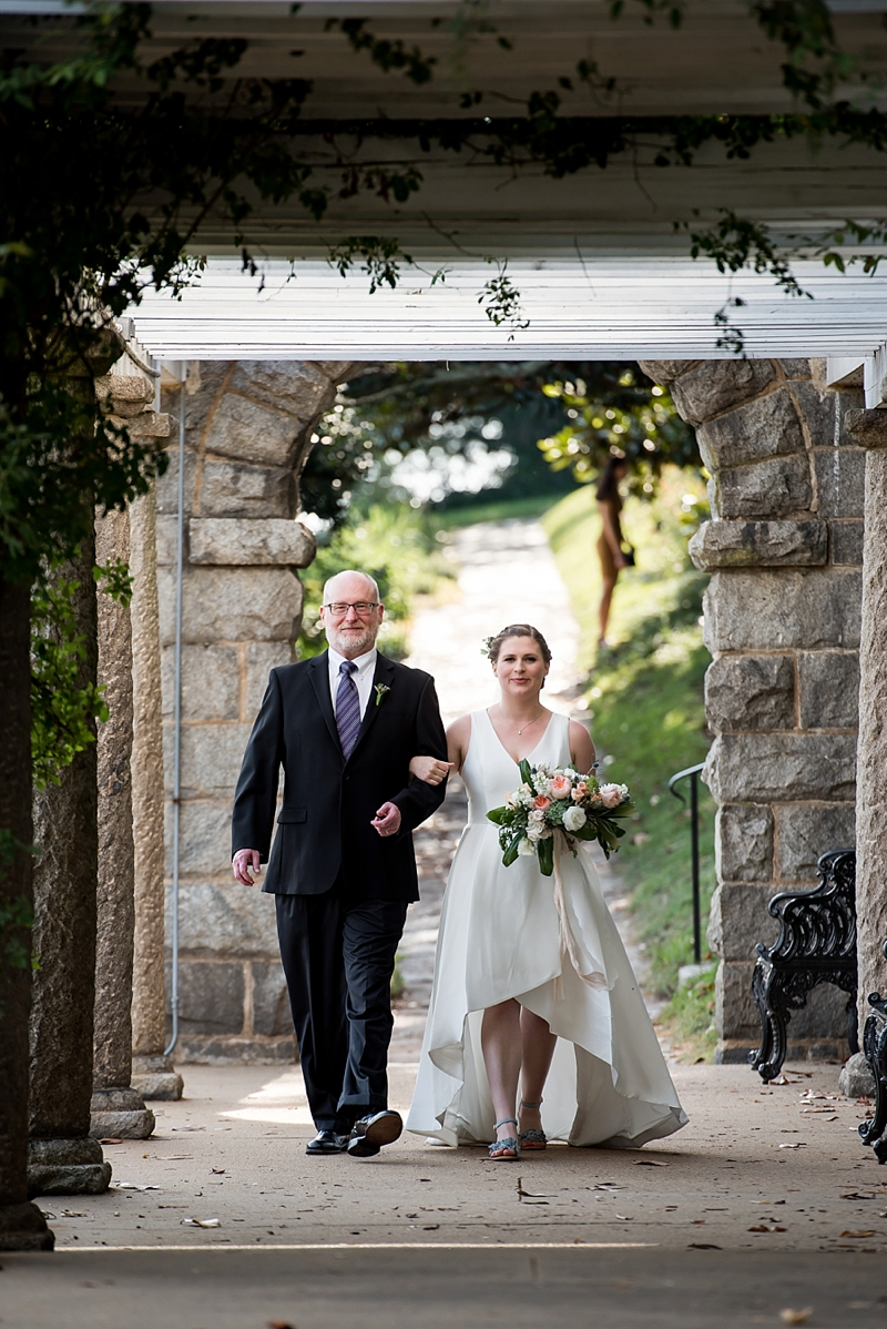 Father and his daughter bride walking down the aisle at Maymont in Richmond Virginia