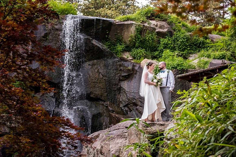 Gorgeous waterfall portraits at Maymont in Richmond Virginia for bride and groom