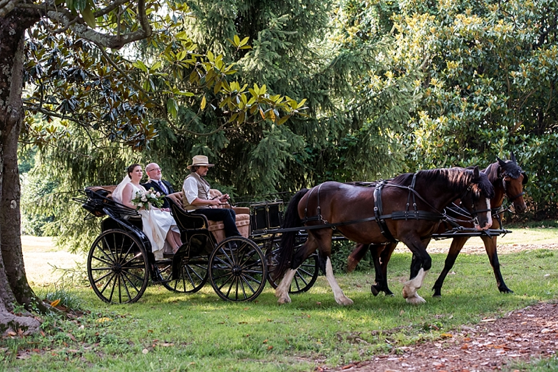Father of the bride and his daughter going to the wedding ceremony by horse and carriage in Richmond Virginia