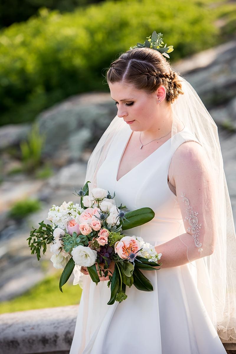 Braided updo and fingertip veil for garden bride at Maymont in Richmond Virginia