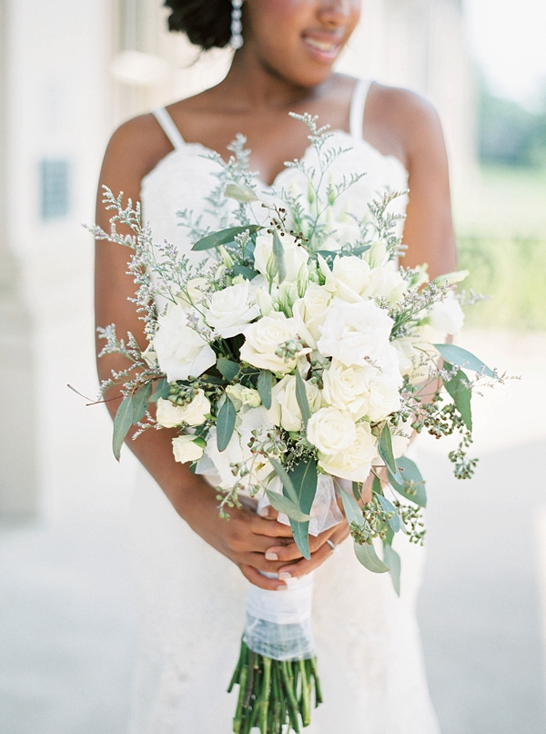 Romantic white wedding bouquet with eucalyptus and roses