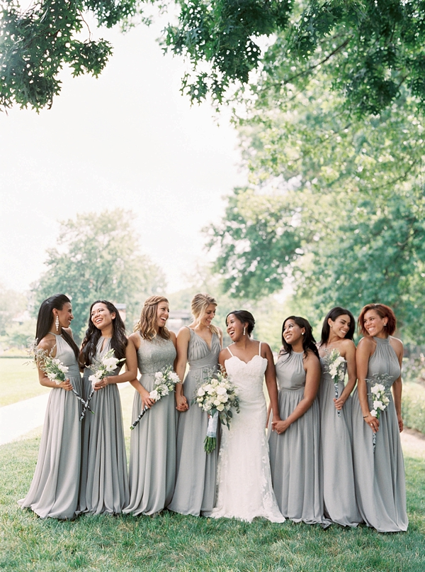 Happy bridesmaids in steel gray dresses