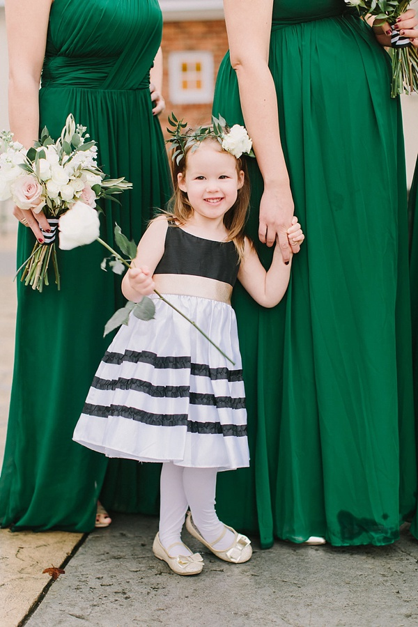 Adorable flower girl with black and white striped dress