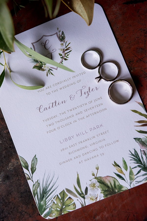 Tropical watercolor wedding invitation with monstera leaves