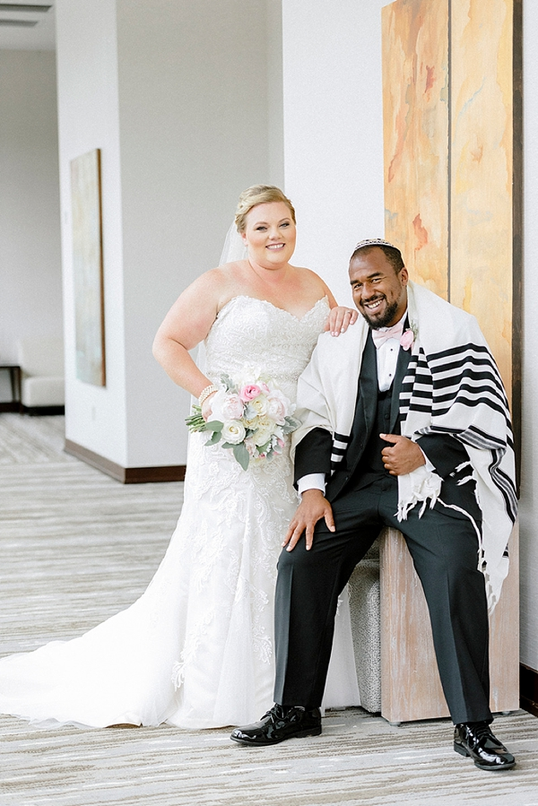Groom wearing a Jewish prayer shawl or tallit