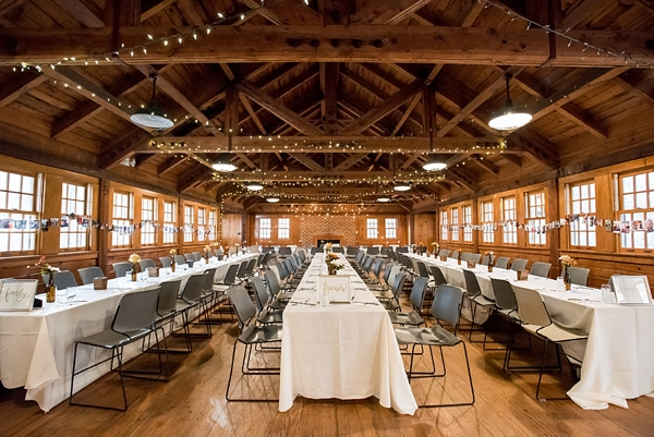 Handmade simple wedding reception with long tables and bistro cafe lights