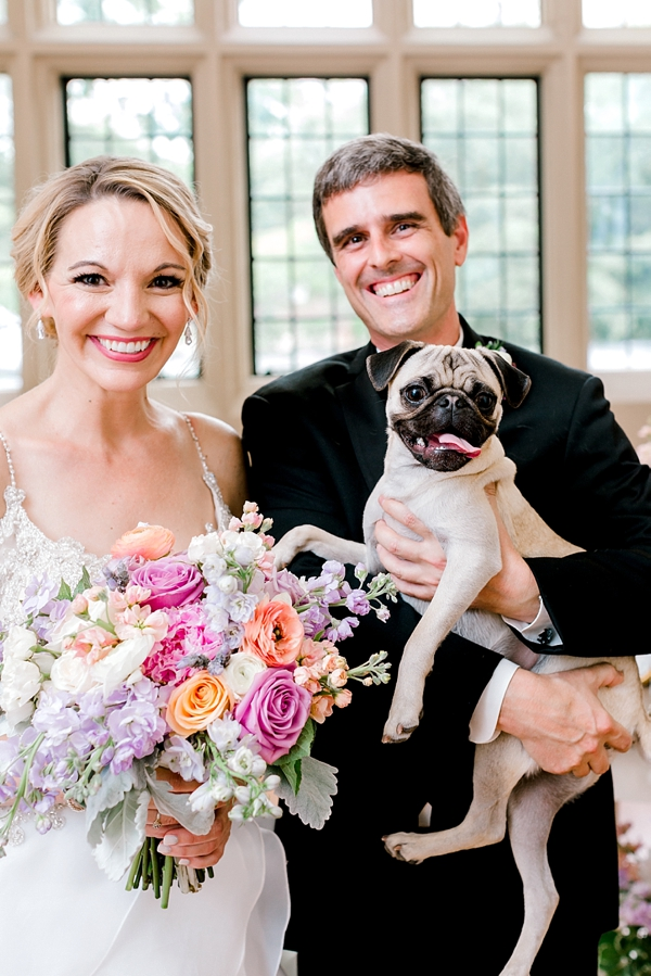 Bride and groom with their cute pug