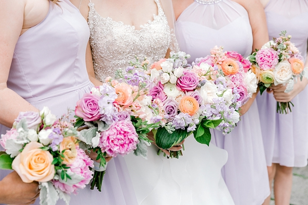 Pink and purple pastel wedding bouquets with ranunculus and peonies