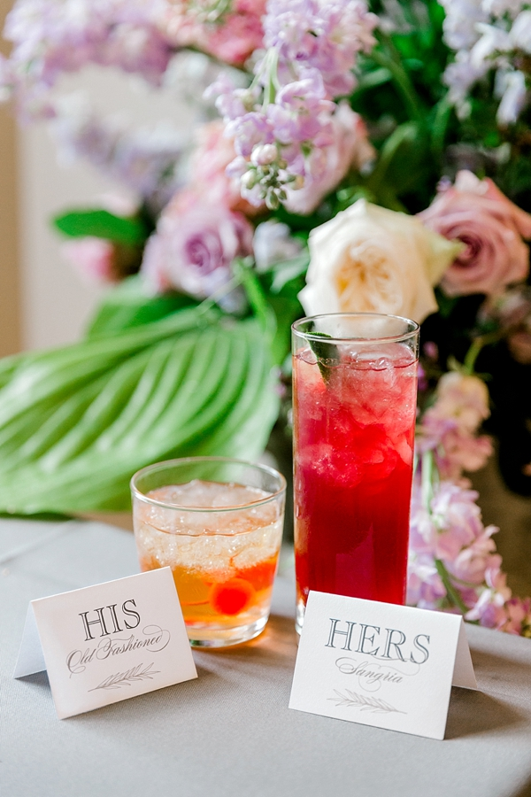 His and her signature wedding cocktails of sangria and old fashioned