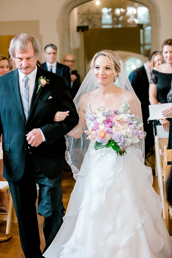 Bride and her dad walking down the aisle at Branch Museum in Richmond Virginia