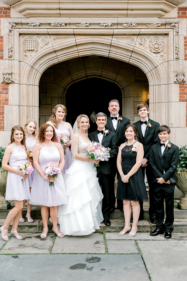 Elegant wedding party with tuxedos and purple lilac bridesmaid dresses