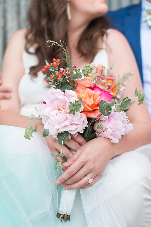 Pretty handmade tropical wedding bouquet with peonies and roses