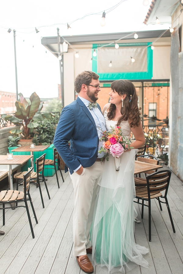 Fabulous rooftop wedding with bride and groom in tropical inspired attire and turquoise dip dye skirt