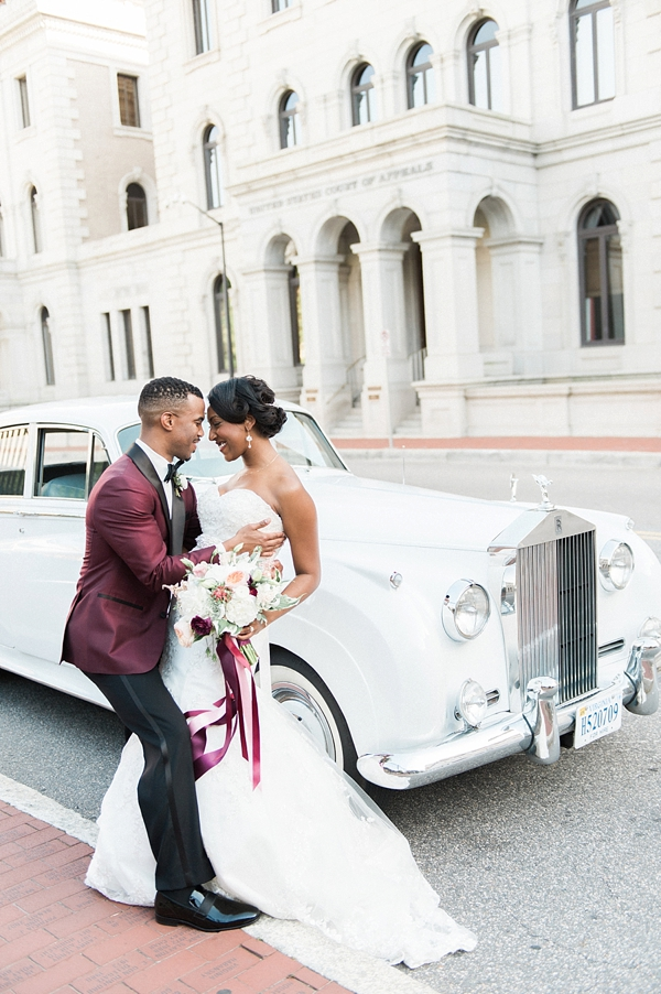 Bride and groom with classic Rolls Royce wedding getaway car