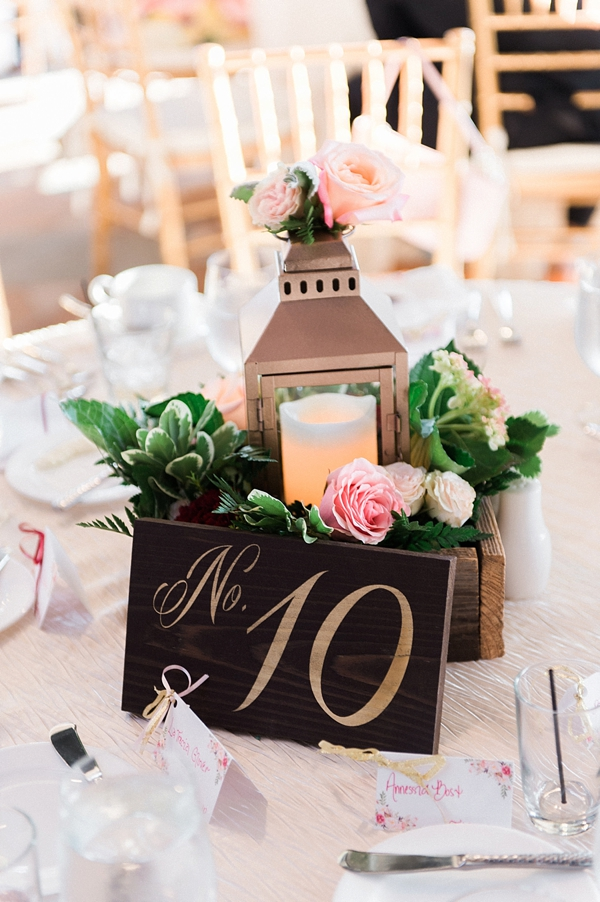 Gold lantern with wooden table number for wedding centerpiece