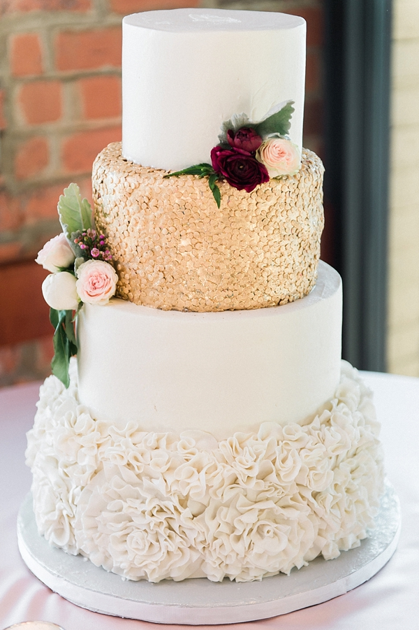 White and gold wedding cake with sugar sequins and ruffles