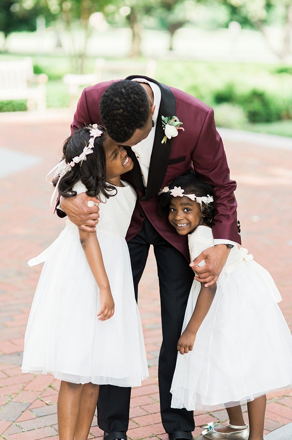 Groom hugging his flower girls