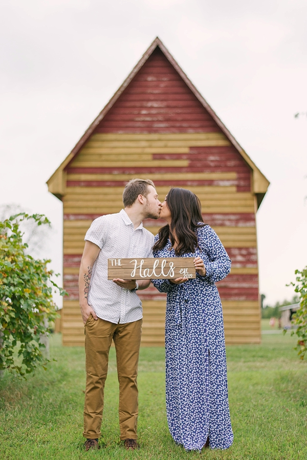 Adorable engagement session kiss at Windsor Castle Park in Smithfield Virginia