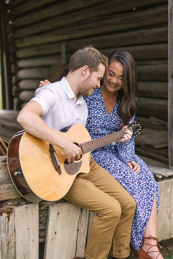 Sweet couple celebrating their engagement with guitar music