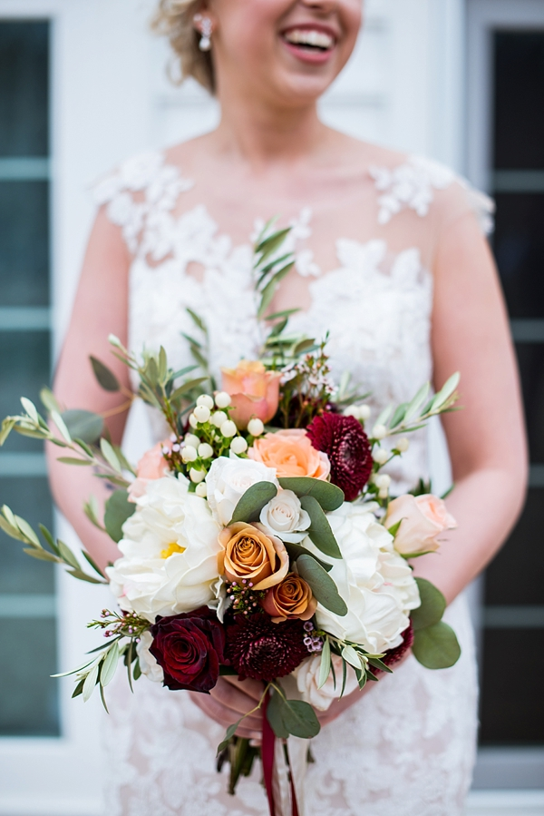 Rustic bridal bouquet with white peonies and dark red roses