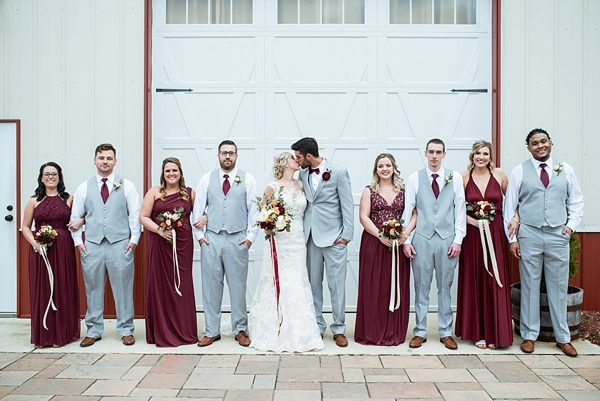 Wedding party in light gray suits and burgundy red dresses