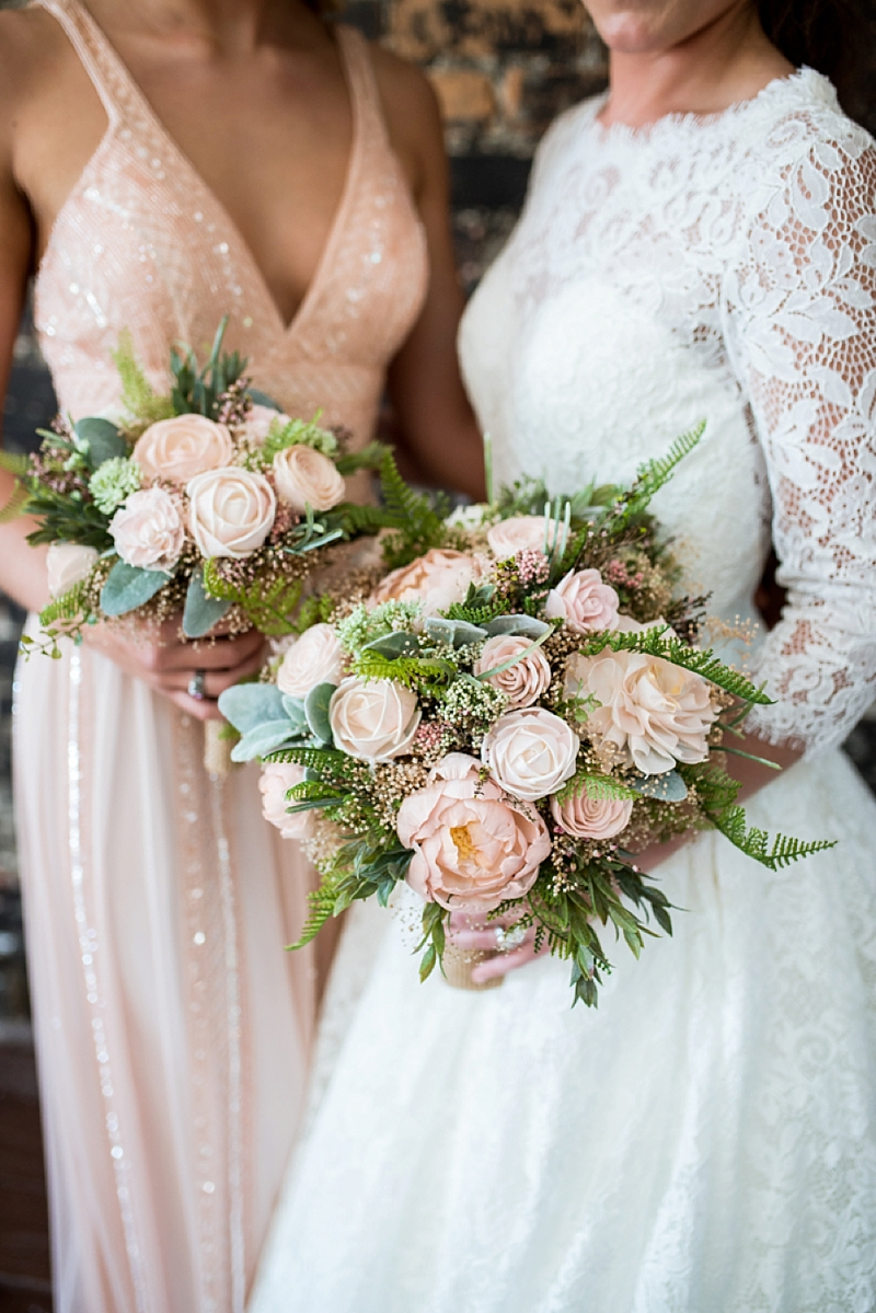 Beautiful faux wedding bouquets with pink wood flowers and ferns