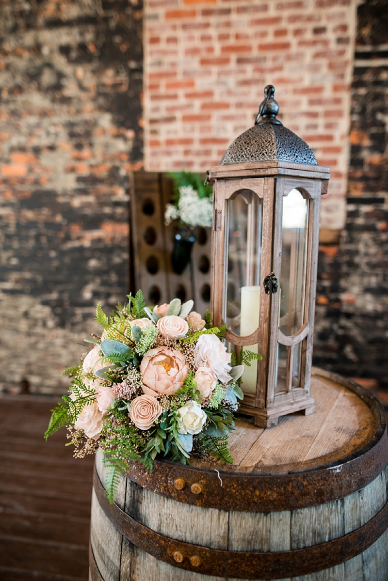 Rustic wooden lantern and wine barrel for Virginia winery wedding