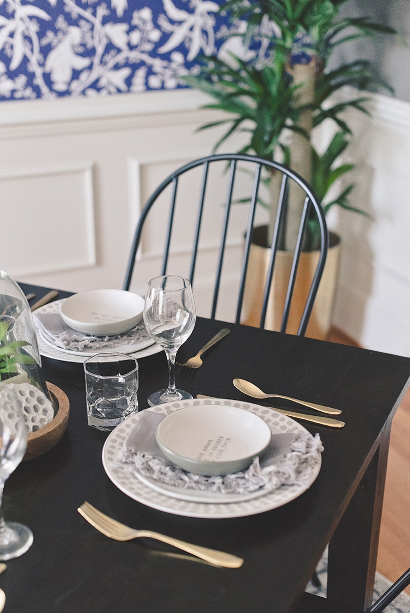 Cozy table setting with gold flatware and handmade bowls