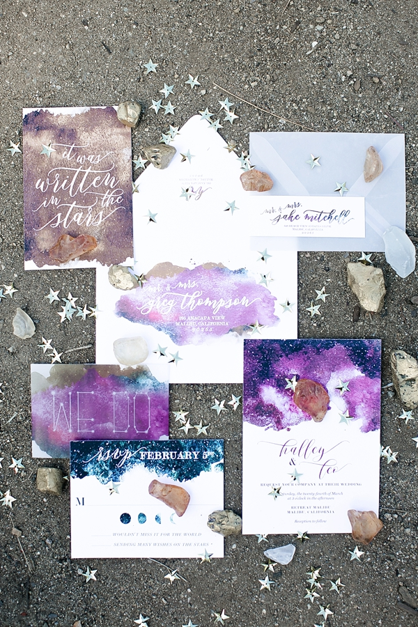 Heavenly celestial wedding invitation suite with watercolor details in purple and blue