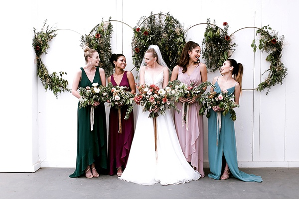 2018 collection of Davids Bridal bridesmaid dresses in moody jewel tones