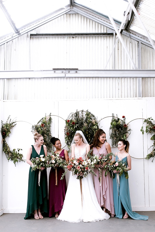 Gorgeous botanical ring ceremony backdrop inspired by the phases of the moon