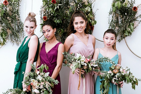 Bridesmaids in mismatched chiffon jewel toned Davids Bridal dresses