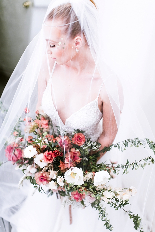 Celestial bride with shimmery eye makeup and silver stars